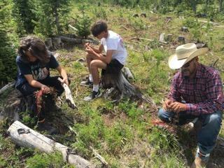 Hezekian, Emilio and Saul making cordage
